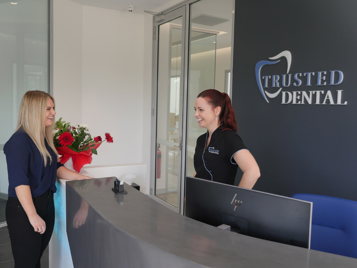 Donna From Trusted Dental Ashmore Greeting Patient