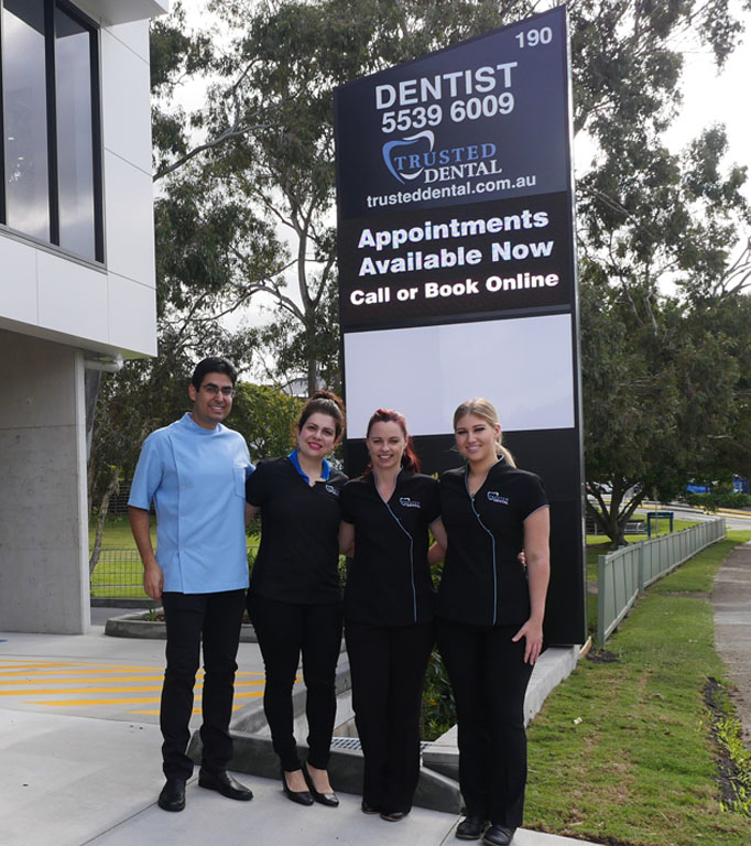 Trusted Dental Ashmore Team and Sign
